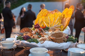 spread of fruit and bread at wedding cocktail hour