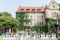 wedding ceremony outdoor venue in front of castle in germany ivy climbing up estate