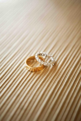Gold men's band and diamond platinum bridal ring