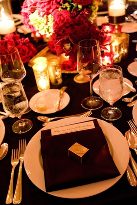 Brown linens topped with gold chocolate box