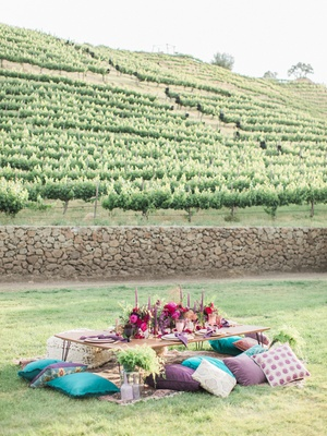 reception table pillow seats bold color scheme california boho chic wedding styled shoot vineyard