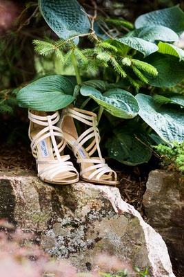Jimmy Choo strappy sandals peep toe ankle straps on rock in upstate new york greenery rustic