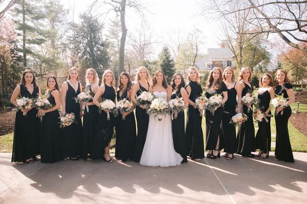 wedding photo bride in reem acra wedding dress bridesmaids in mismatched black dresses long