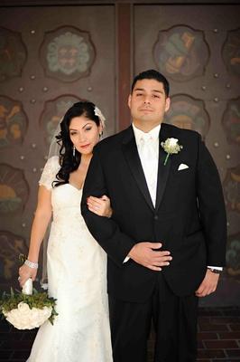 Lace-sleeved wedding dress and white vest tuxedo