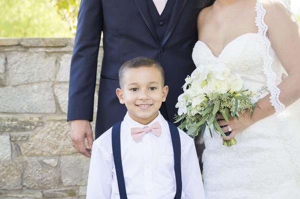 brides son smiles couple pink bowtie happy catholic ceremony california wedding suspenders navy