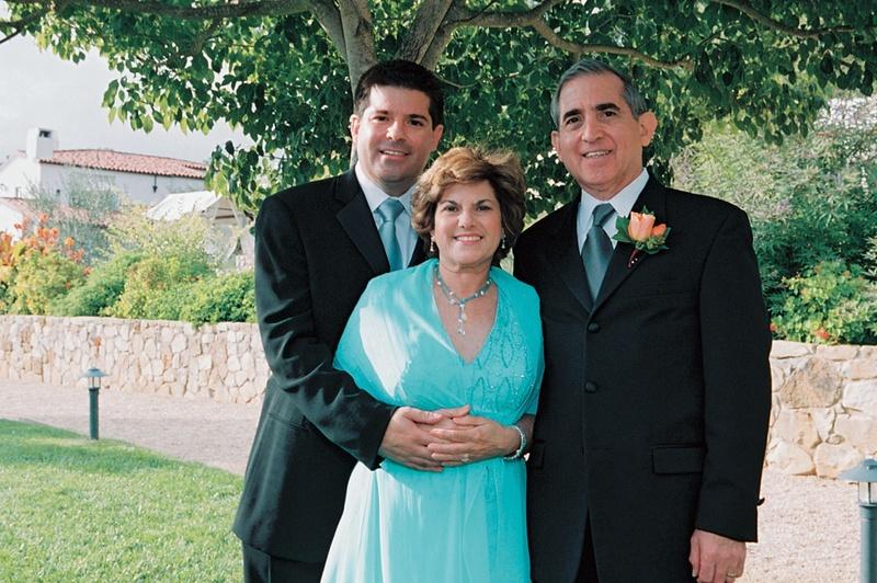 groom hugs mom standing next to dad