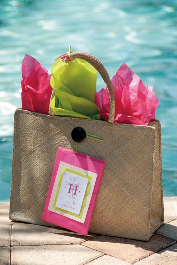 Brown tote bag filled with pink and green paper