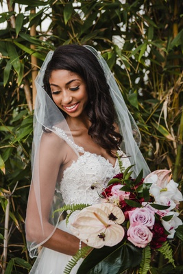 modern tropical bridal bouquet with burgundy flowers, pink roses, laceleaf, orchids, ferns