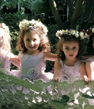 Four flower girls with flower crowns and belts