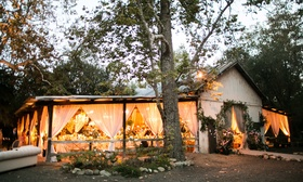 Santa Barbara Dos Pueblos Ranch in forest countryside open sides barn with blush drapery garlands