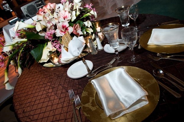 Textured tablecloth and floral centerpiece