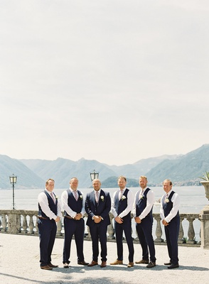 wedding on lake como in italy destination groom in navy suit and groomsmen in navy slacks and vests
