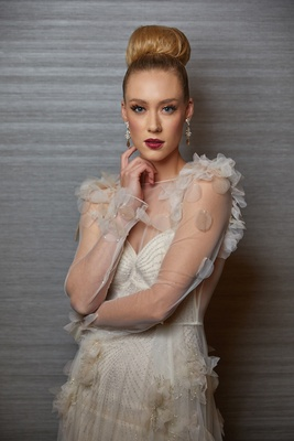 bold makeup look bride styled shoot inbal dror wedding gown designer hairstyle
