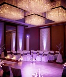 Floating candles and crystal chandelier lighting