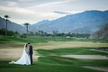 Wedding portrait on golf course in palm springs area la quinta resort and club bride and groom