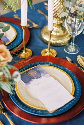 beauty beast movie styled wedding shoot red blue yellow gold changers watercolor vintage menu