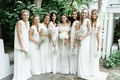 bride and bridesmaids in white dresses harbour island destination wedding bahamas baby's breath