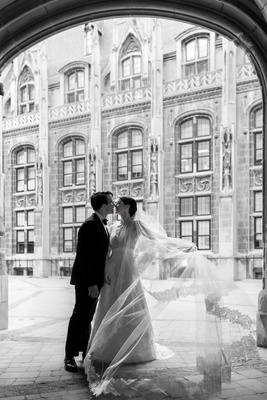 black and white photo of bride in lace v neck carolina herrera groom in ralph lauren, cathedral veil