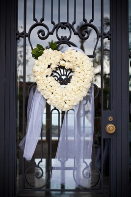 Floral wreath in the shape of a heart on door