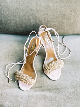 Aquazzura white ivory wedding shoes with lace up ankle strap and crystal detail on toe strap