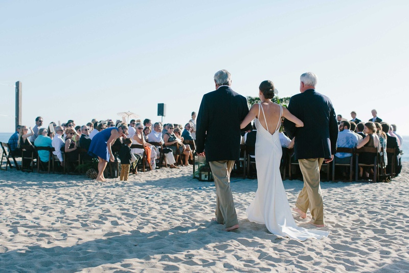 father stepfather walk bride down aisle beach wedding oceanside california blending family ceremony