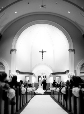 Black and white photo of Catholic church wedding ceremony