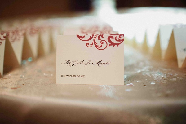 Place card with red scroll design