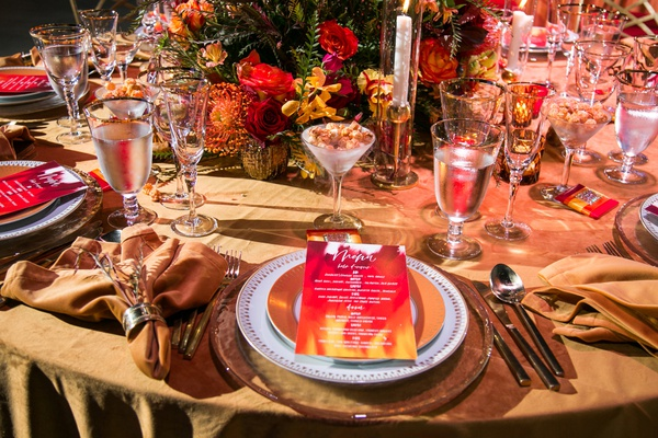fire inspired wedding styled shoot, watercolor menu cards in warm colors red orange yellow.
