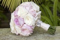 Pink and white garden roses in wedding bouquet