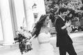 Black and white photo of couple leaving church