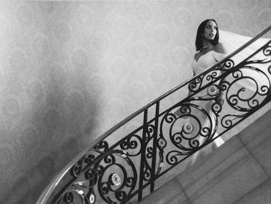 black and white photo of cheryl burke dancing with the stars on staircase in wedding dress