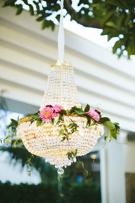 chandeliers with flowers at outdoor ceremony hanging from tree