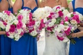 bridesmaid bouquets with lavender freesia and roses, fuschia, ivory, and white roses