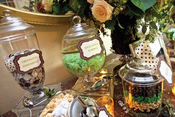 Glass apothecary jars filled with reception candy