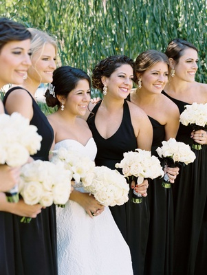 Black mismatch neckline halter long bridesmaid dress with white rose and calla lily bouquets