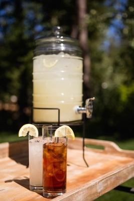 Lemonade and iced tea in glass with lemon slice garnish