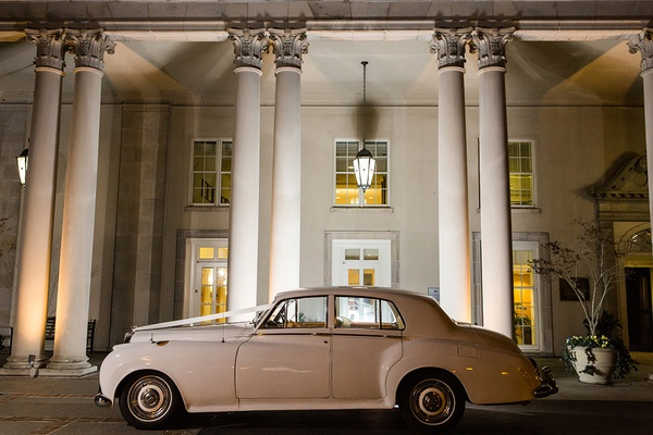 Car waiting for newlyweds 1956 White Bentley Sedan