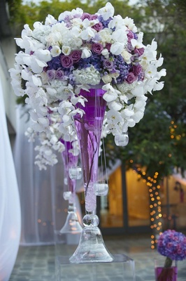 White orchid and purple rose flowers in violet water