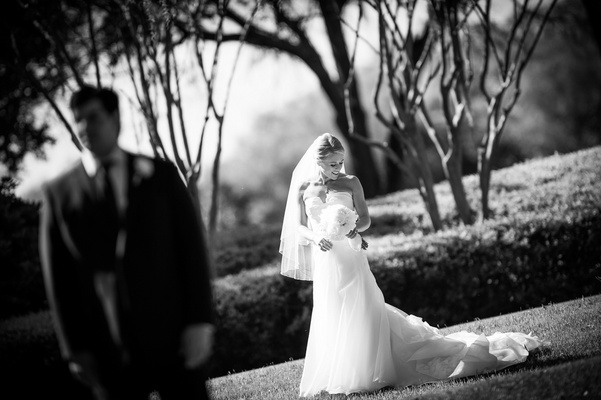 Black and white photo of bride before first look