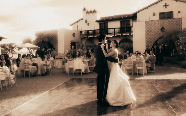 Sepia toned photo of bride and groom dancing