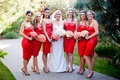 Short red-orange bridesmaid dresses and bouquets