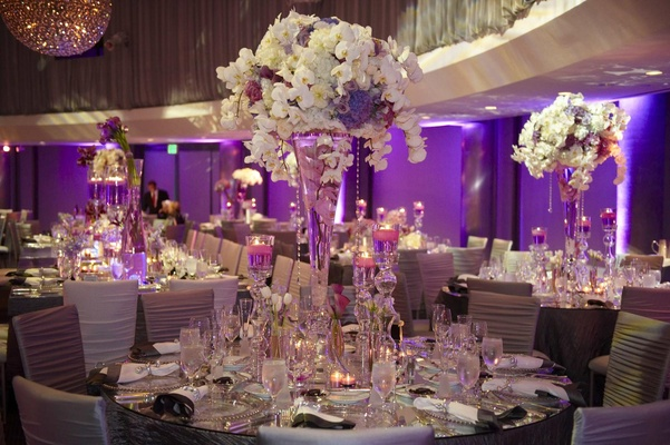 Purple, white, and silver wedding reception decorations