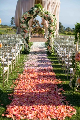 Alfresco ceremony decor with floral arch and rotunda