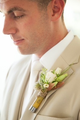 Rustic boutonniere with game shock ammo tie and white roses