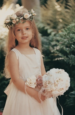 Pretty flower girl with rose flower crown and belt
