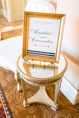 Mirror side table with gold frame black white striped design cocktails and conversation sign party