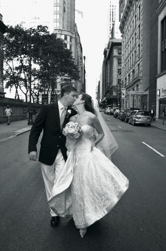 Black and white photo of newlyweds in street