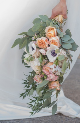 bridal bouquet with eucalyptus greenery, white anemone, peach roses, blush roses