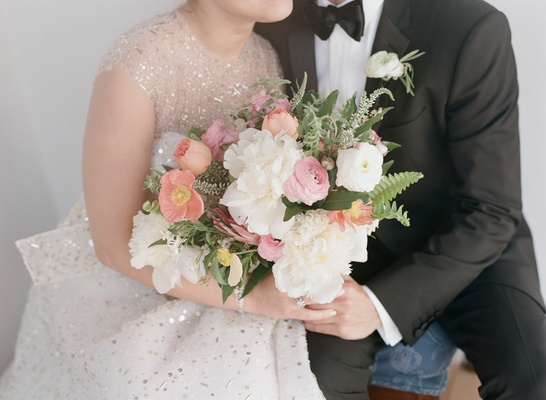 Light wedding color palette unstructured bouquet with peony, ranunculus flowers