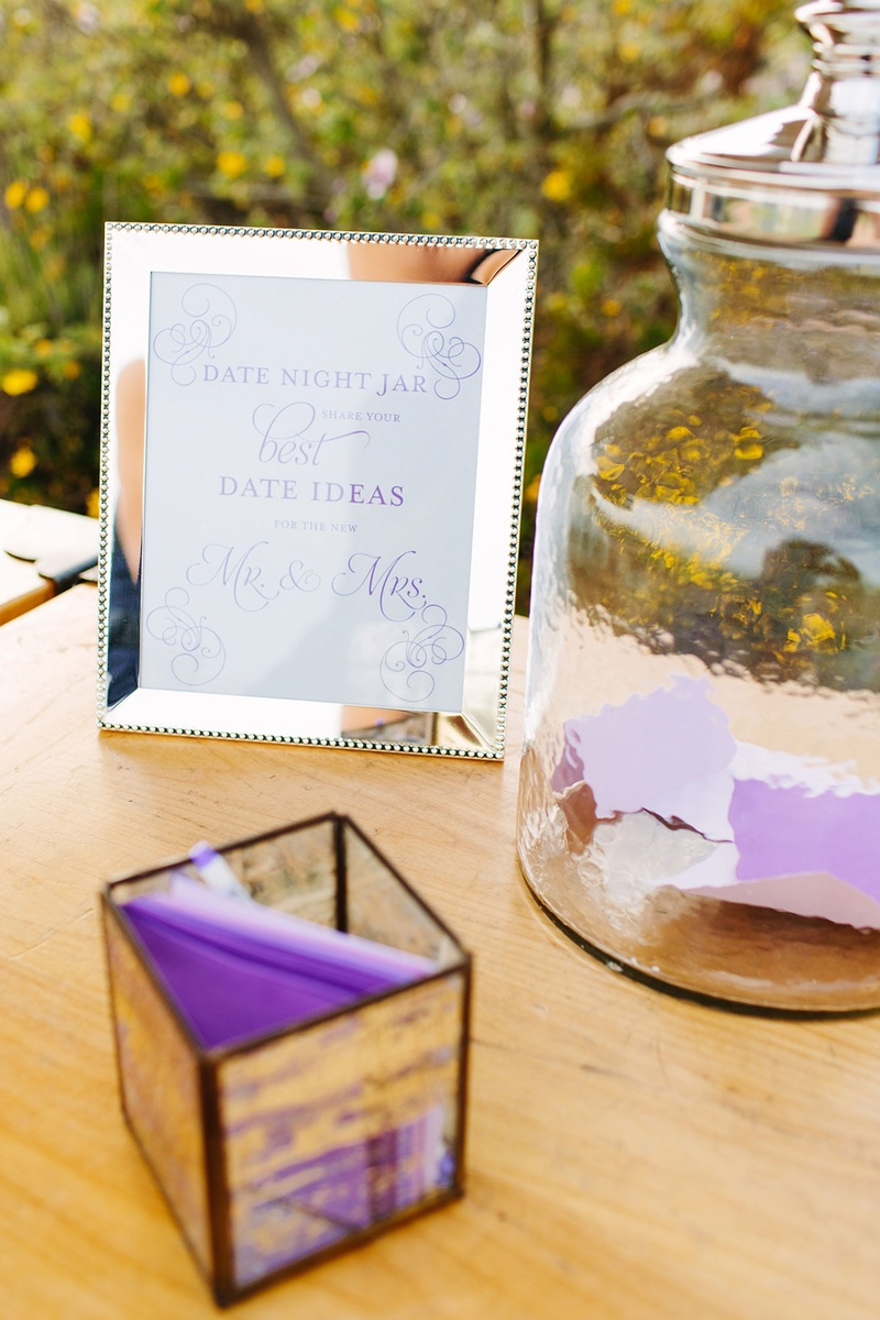 date night idea jar at wedding ceremony reception purple and white calligraphy
